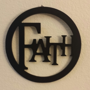 I have this sign hanging on my wall at home. Faith.